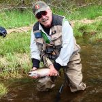 Author and Guide Tom Welch prepares to release this 18-inch beauty, caught on a wet hare's ear fly on the Magalloway.